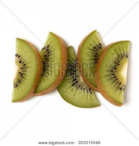 kiwi fruit slices isolated on white background closeup. Half of kiwi slice. Kiwifruit slice,  flatlay. Flat lay, top view.