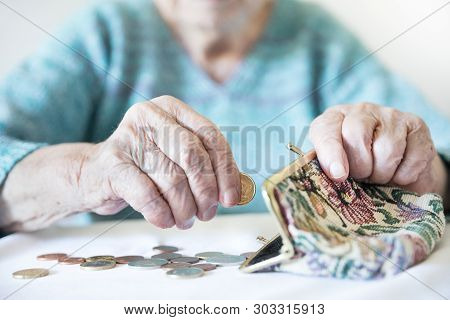 Detailed Closeup Photo Of Unrecognizable Elderly Womans Hands Counting Remaining Coins From Pension