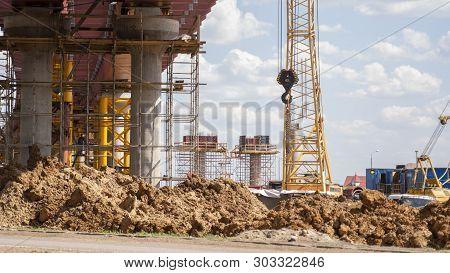 Construction of an overpass bridge. Reinforced concrete structures. poster