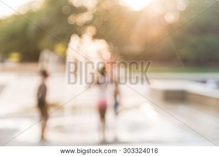 Blurry Background African American Children Playing At Water Splash Park