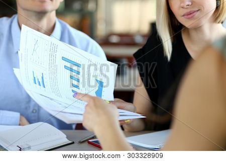 Selective Focus On Business Documents. Group Of Corporate Working People Negotiating New Startup. Ma