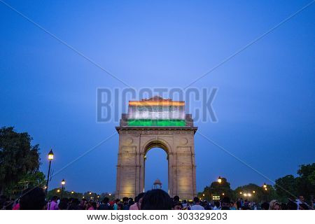 New Delhi, India - April 2019 : India Gate In Evening With Twilight Sky And Crowd Of Local People An