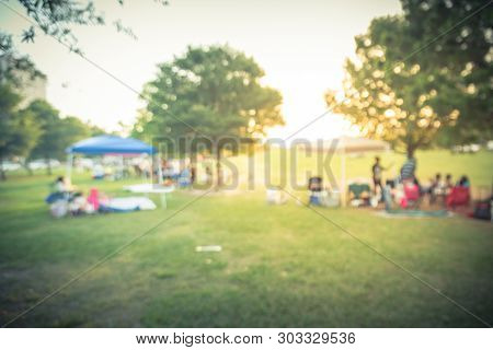 Blurry Background People Enjoy Bbq And Camping In Local Park At Sunset