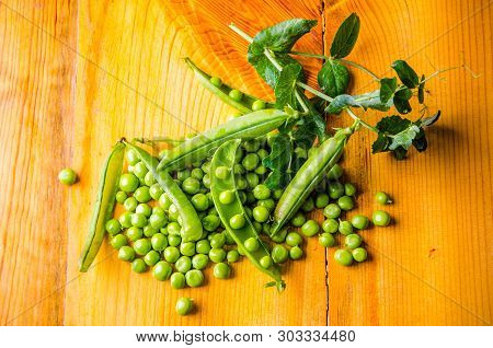 Juicy Beans. Ripe Green Peas On Wooden Boards
