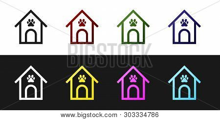 Set Dog house and paw print pet icon isolated on black and white background. Dog kennel. Vector Illustration poster