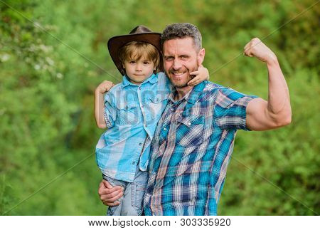 Rustic Family. Growing Cute Cowboy. Small Helper In Garden. Little Boy And Father In Nature Backgrou