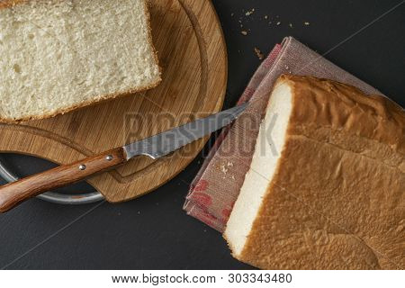 Freshly Baked Sliced White Bread With Metal Knife, Toasts For Cooking Sandwitchs