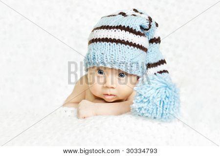 Newborn Baby Closeup Portrait In Blue Woolen Hat
