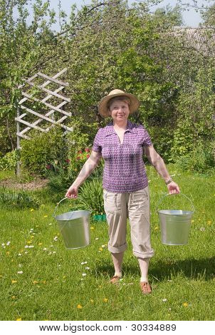 The Rural Woman With A Bucket