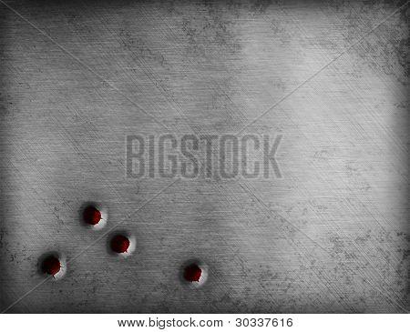 bullet holes on metal plate