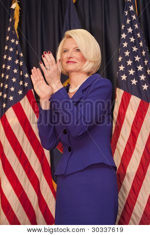 Calista Gingrich claps for Newt.