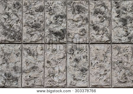 Natural Stone Wall Vertical Blocks. The Texture Of The Stone Lined With Blocks Of Natural Limestone