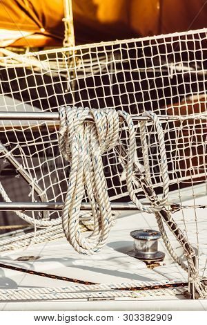Recreational Yacht Detail With Ropes And Other Equipment. Filtered Shot With Sun Reflection In Backg
