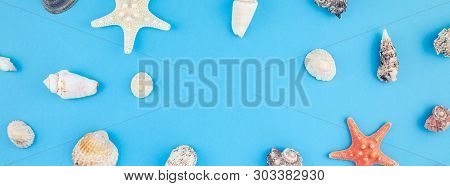 Creative Flat Lay Concept Of Summer Travel Vacations. Top View Of Seashells And Starfish On Turquois