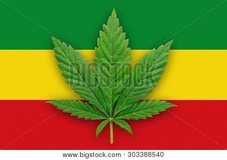 Cannabis Leaf On A Green-yellow-red Flag Background. Rastaman Flag.
