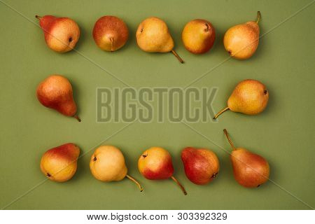 Colorful Fruit Pattern Or Background. Ripe Fresh Juicy Pears Placed On Green Background