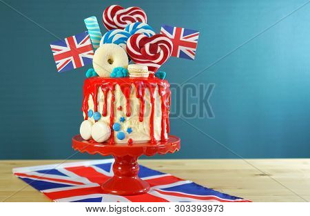 Uk Candyland Drip Cake With Red White And Blue Decorations, Lollipops And Flags.