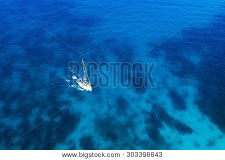 Greece, Santorini. Greece Seascape With Yacht. Yachting Background. White Yacht In Clear Blue Sea. A