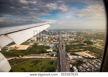 Aerial View From Window Of Airplane. Flying Above Bangkok.