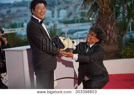 Bong Joon-Ho with Kang-Ho Song poses during the Award Winners photocall at the 72 Cannes Film Festival in Cannes, France on May 25, 2019.