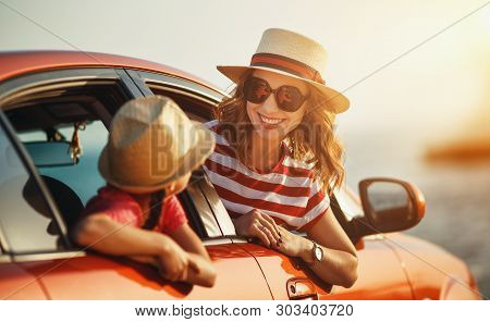 Happy  Family Mother And Child Girl Goes To Summer Travel Trip In The Car
