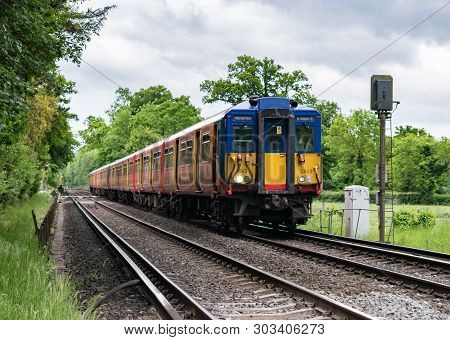 Mickleham, Surrey, Uk - May 26 2019: A Train Driver Waves As His Class 455 South Western Railway Pas