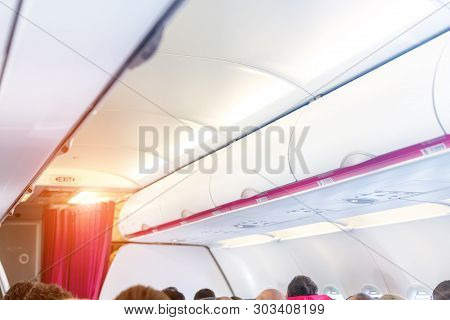 Closed Shelves For Hand Luggage At Airplane. Aircraft Interior During Regional Flight