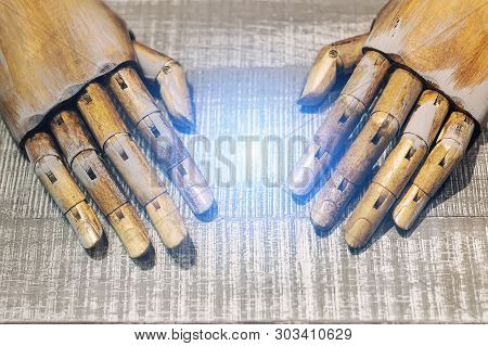 Close-up Pair Of Wooden Dummy Hands And Blue Light Between. Care About  New Idea Concept