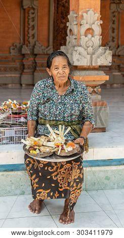Dusun Ambengan, Bali, Indonesia - February 25, 2019: Clan Compound. Closeup Of Older Woman With Plat