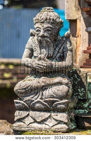 Dusun Ambengan, Bali, Indonesia - February 25, 2019: Clan Compound. Closeup Of Gray Stone Sitting Gu