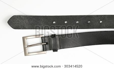 Black Leather Belt On White Background. Items Of Clothing And Equipment