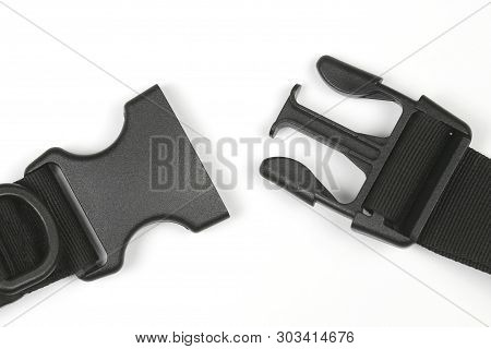 Black Plastic Fastex Clip For Backpacks On A White Background. Items Of Clothing And Equipment