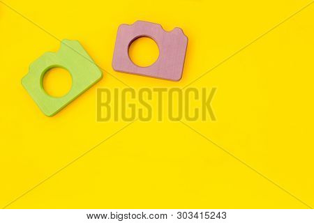 Photo Camera Concept On Yellow Background Top View Mock Up