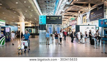 Interior View Of Lisbon International Airport Where Travelers Walk