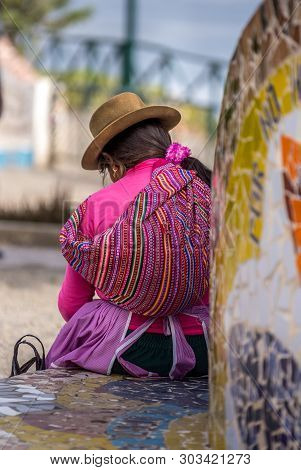 A Peruvian Woman In Native Clothing In Lima, Peru