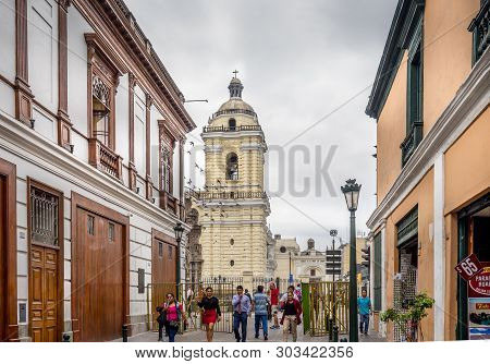 Lima Peru - April 29, 2019 - Visitors Walking In And Out On The Street Near Cathedral Of Lima