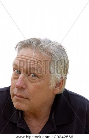 closeup of man looking at camera with a quizzical expression face