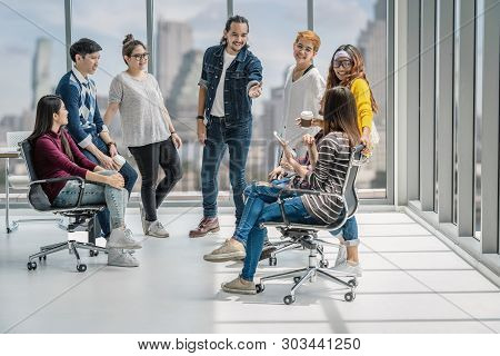 Group Of Asian And Multiethnic Business People With Casual Suit Talking And Brainstorming With Happy