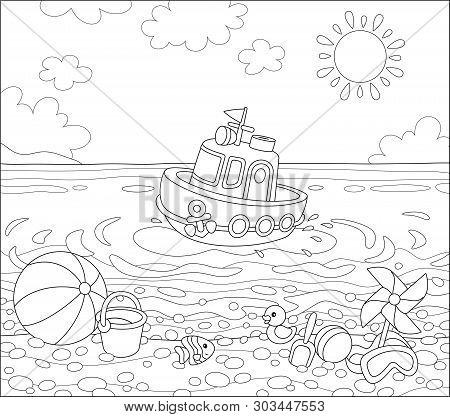 Funny Ship Floating In Water And Other Baby Toys On Sand Of A Sea Beach On A Sunny Summer Day, Black