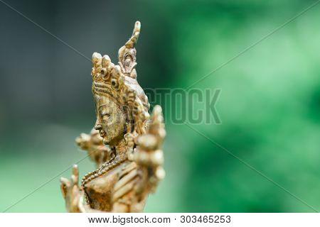 Ancient Buddhist figurine made of bronze up close