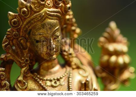 Ancient Buddhist figurine made of bronze up close