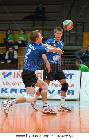 KAPOSVAR, HUNGARY - FEBRUARY 23: Bence Bozoki (2) in action at a Hungarian volleyball National Championship game Kaposvar (blue) vs. Csepel ( deep blue), on February 23, 2012 in Kaposvar, Hungary.