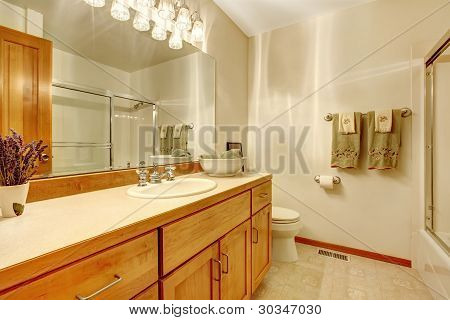 Outdated Simple Bathroom With Wood Cabinets,