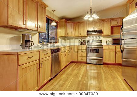 Yellow Warm Wood Kitchen With New Floor.