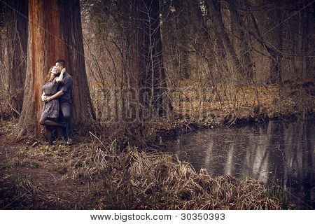 Young happy couple hugging with passion outdoors