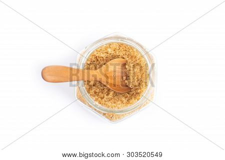 Brown Sugar  In A Glass Jar Isolated On White Background, Top View