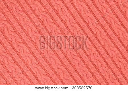 Trendy coral colored Knitwear Fabric Texture with Pigtails and stripes. Repeating Machine Knitting Texture of Sweater. Knitted Background. Diagonal composition. poster