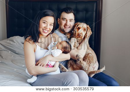 Smiling Chinese Asian Mother And Caucasian Father With Mixed Race Newborn Infant Baby Son Daughter A