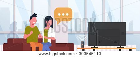Couple Watching Tv Man Woman Sitting On Couch Using Smart Speaker Voice Recognition Activated Digita