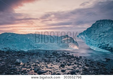 Beautiful Sunrise Over Famous Diamond Beach In Iceland. This Sand Lava Beach Is Full Of Many Giant I